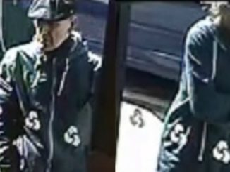 Police want to speak to two people in connection with a bank robbery in Didsbury